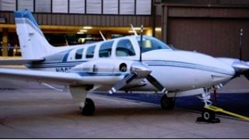 twin engine airplane white with blue and silver stripes350 197