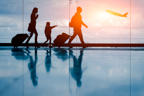 family walking in airport500 333